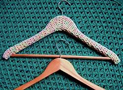 Padded coat hanger with crochet flowers - Coats Crafts UK home
